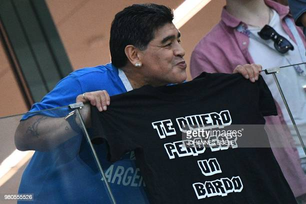 Argentina's football legend Diego Maradona poses with a tshirt reading 'I love you but i'm a mess' in the grandstand before the Russia 2018 World Cup...