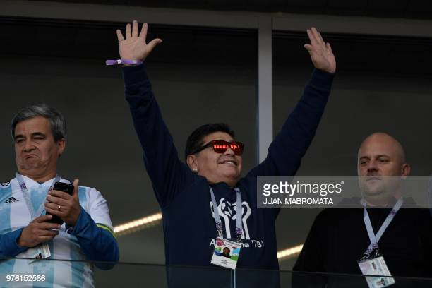 TOPSHOT Argentina's football legend Diego Maradona waves to the crowd ahead of the Russia 2018 World Cup Group D football match between Argentina and...