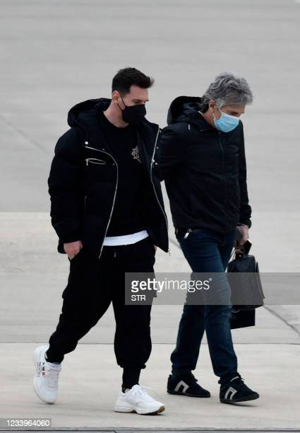 Argentina's football player Lionel Messi and his father Jorge Messi arrive at the Islas Malvinas airport in Rosario, Santa Fe province, Argentina, on...