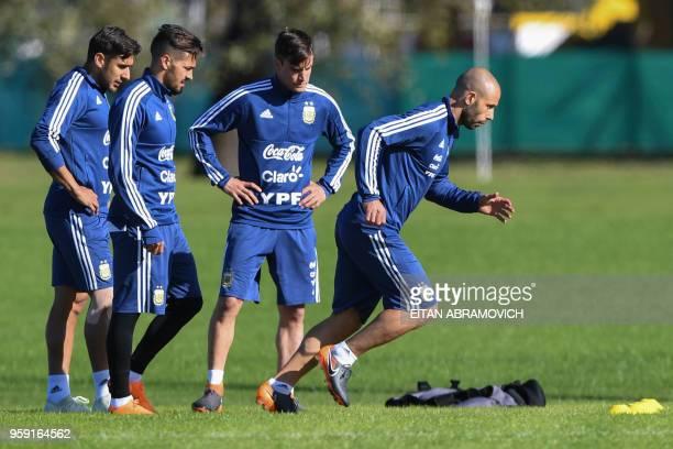 Argentina's football players Eduardo Salvio Manuel Lanzini Nicolas Tagliafico and Javier Mascherano take part in a training session in Buenos Aires...