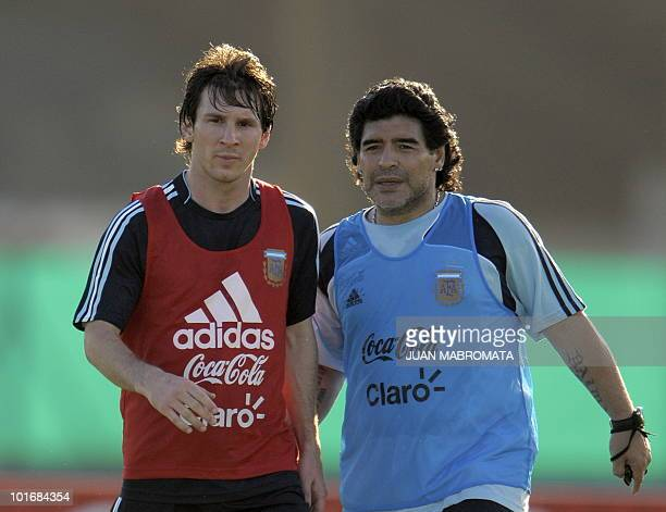 Argentina's football team coach Diego Maradona speaks with forward Lionel Messi during a training session in Ezeiza, Buenos Aires on March 24, 2009....