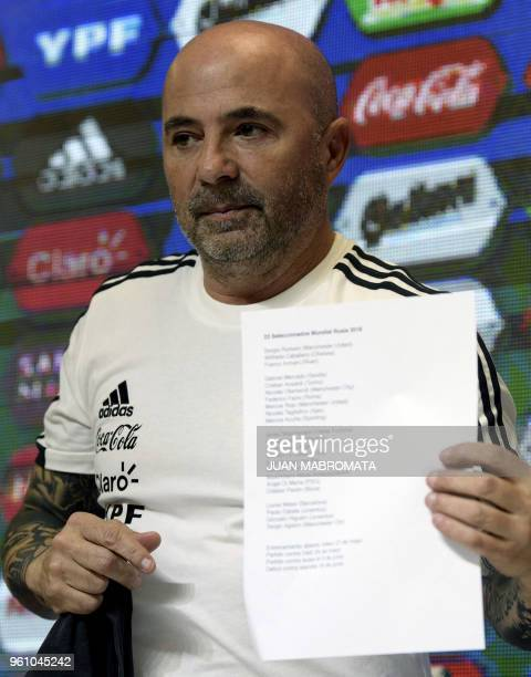 Argentina's football team coach Jorge Sampaoli shows the list bearing the 23men squad for the FIFA World Cup Russia 2018 during a press conference in...