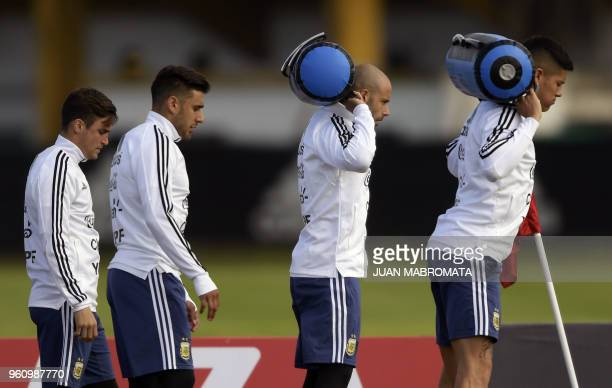 Argentina's football team defender Javier Mascherano defender Eduardo Salvio midfielder Giovani Lo Celso and defender Marcos Rojo take part in a...