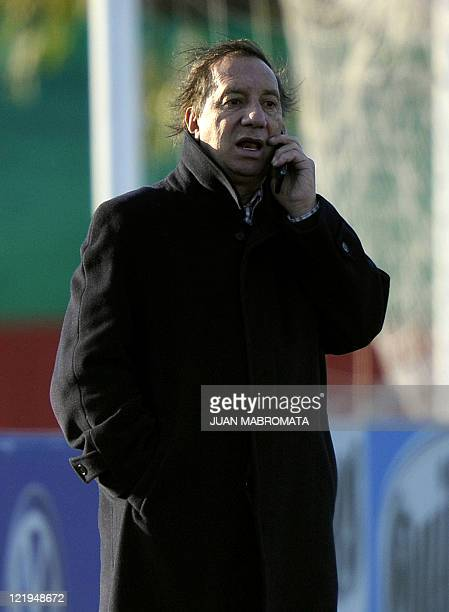 Argentina's football team manager Carlos Bilardo speaks on his mobile phone during a training session in Ezeiza Buenos Aires on August 23 2011 AFP...