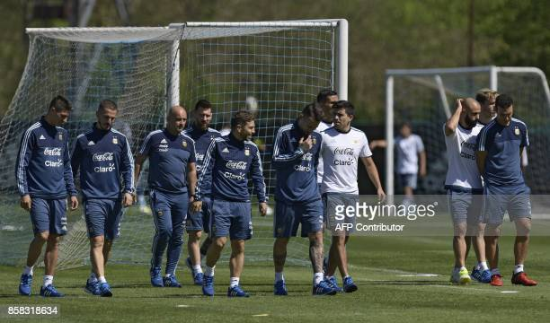 Argentina's football team members midfielder Emiliano Rigoni forward Dario Benedetto physical trainer Jorge Desio forward Lionel Messi midfielder...