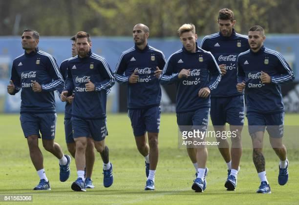 Argentina's footballers defender Gabriel Mercado midfielder Marcos Acuna forward Lionel Messi midfielder Guido Pizarro midfielder Lucas Biglia...