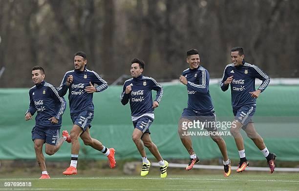 Argentina's footballers forward Angel Correa defender Martin Demichelis midfielder Nicolas Gaitan defender Marcos Rojo and defender Ramiro Funes Mori...
