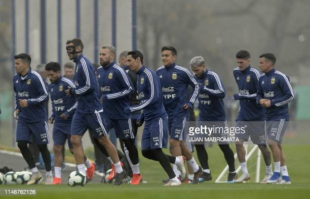 Argentina's footballers jog during a training session of the national team in Ezeiza Buenos Aires on May 28 ahead of the Copa America football...