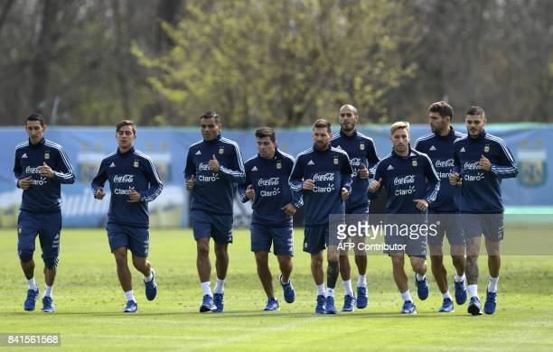 Argentina's footballers midfielder Angel Di Maria forward Paulo Dybala defender Gabriel Mercado midfielder Marcos Acuna forward Lionel Messi...