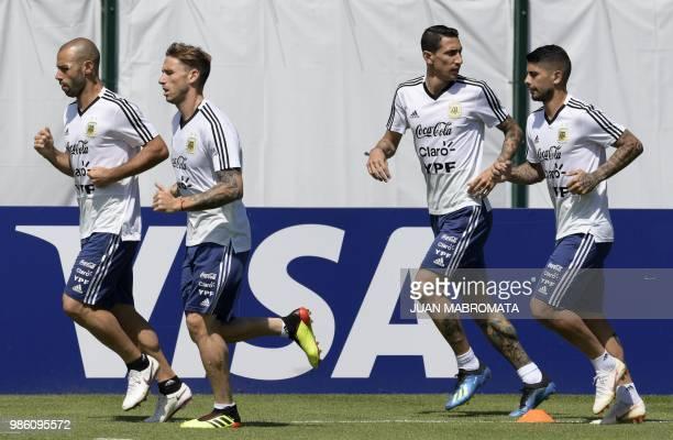 Argentina's footballers midfielder Javier Mascherano midfielder Lucas Biglia midfielder Angel Di Maria and midfielder Ever Banega jog during a...