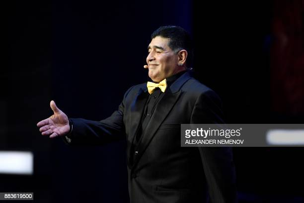 Argentina's former midfielder Diego Maradona arrives on stage ahead of the 2018 FIFA World Cup football tournament final draw at the State Kremlin...