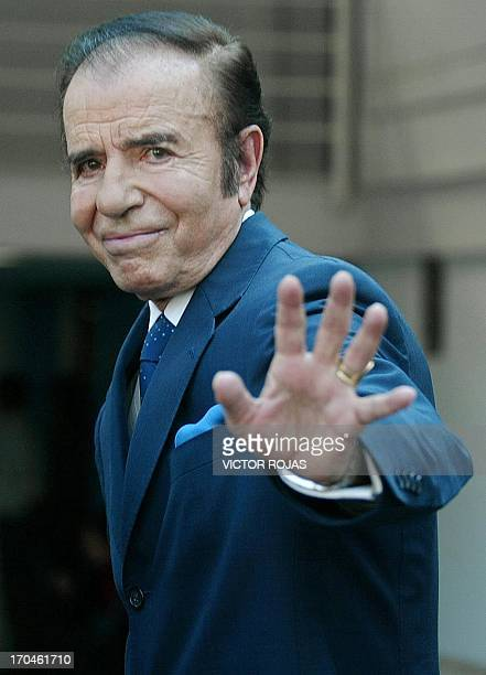 Argentina's former president Carlos Menem waves at the press after the taping of an interview for a Chilean TV programme in Santiago Chile on...