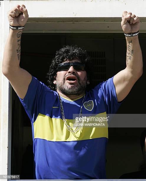 Argentina's former soccer star Diego Maradona waves Boca Junior's team before the Argentina's first division soccer match against Gimnasia y Esgrima...