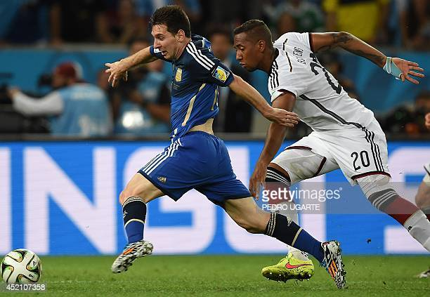 Argentina's forward and captain Lionel Messi and Germany's defender Jerome Boateng vie for the ball during the second half of the 2014 FIFA World Cup...