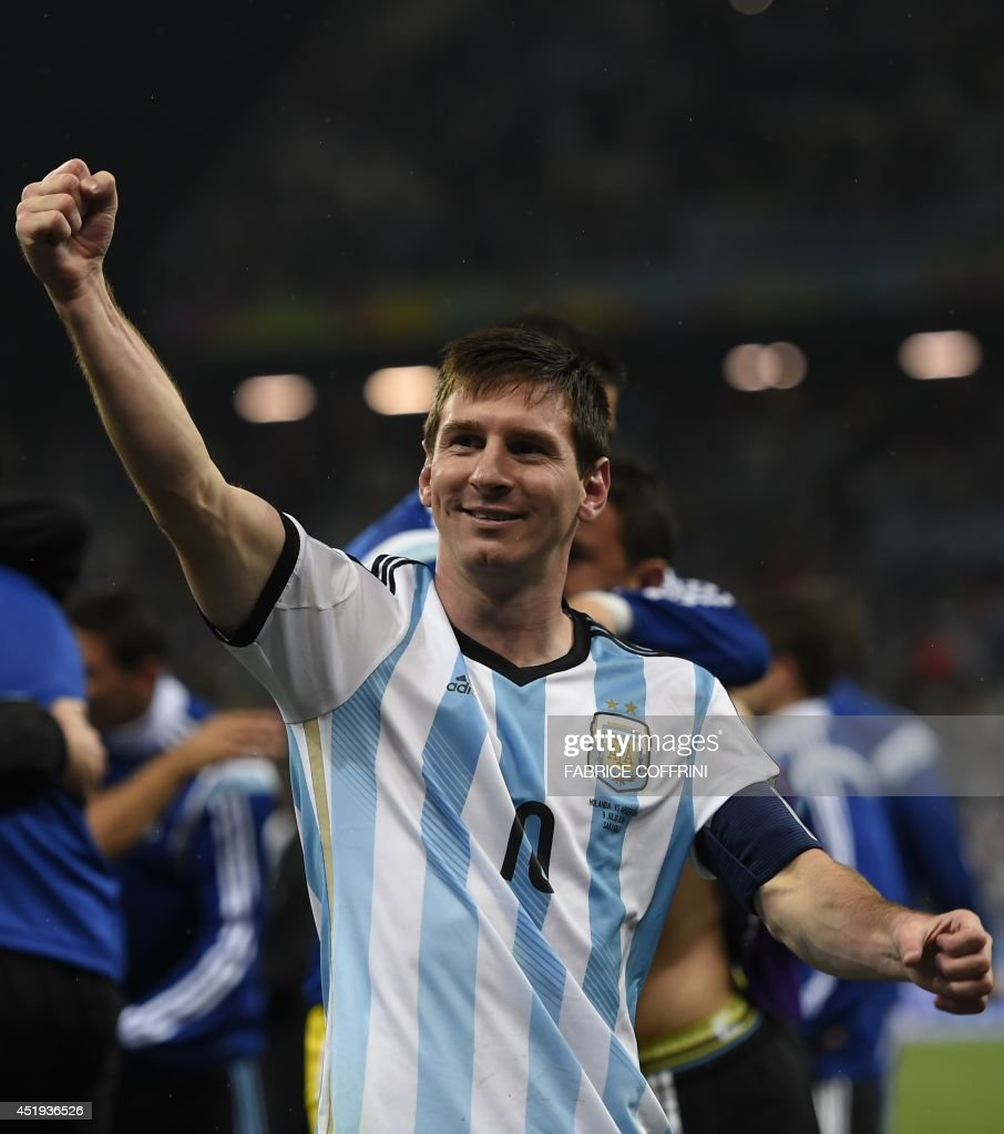 Argentina's forward and captain Lionel Messi celebrates after winning their FIFA World Cup semi-final match against the Netherlands in a penalty shoot-out following extra time at The Corinthians Arena in Sao Paulo on July 9, 2014. AFP PHOTO / FABRICE COFFRINI / AFP PHOTO / Fabrice COFFRINI
