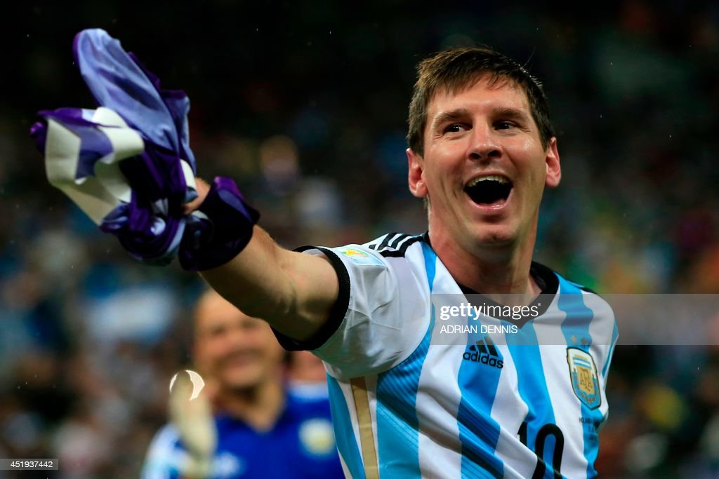 Argentina's forward and captain Lionel Messi celebrates his team's victory at the end of the semi-final football match between Netherlands and Argentina of the FIFA World Cup at The Corinthians Arena in Sao Paulo on July 9, 2014. Argentina won 4-2 on penalties. AFP PHOTO / ADRIAN DENNIS / AFP PHOTO / Adrian DENNIS
