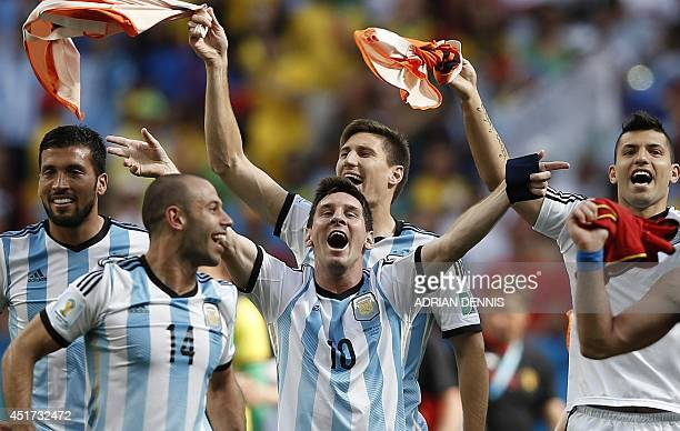 Argentina's forward and captain Lionel Messi celebrates with teammates after winning the quarterfinal football match between Argentina and Belgium at...