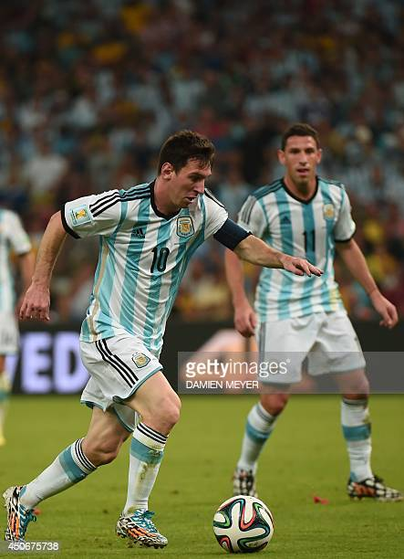 Argentina's forward and captain Lionel Messi controls the ball during a Group F football match between Argentina and BosniaHercegovina at the...