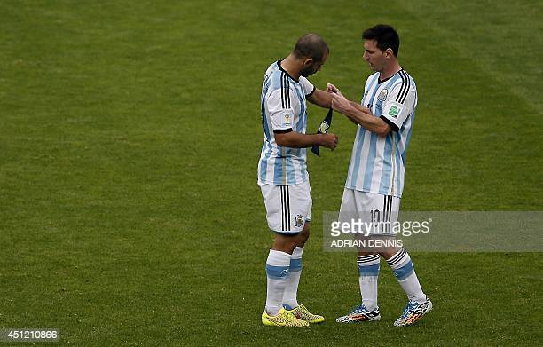 Argentina's forward and captain Lionel Messi hands the captain's armband to Argentina's midfielder Javier Mascherano after substitution during the...