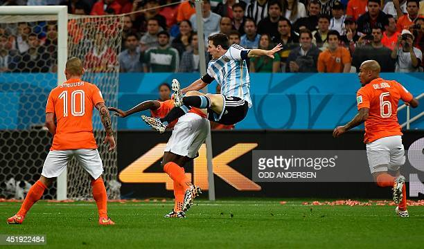 Argentina's forward and captain Lionel Messi makes an attempt on goal during the semifinal football match between Netherlands and Argentina of the...