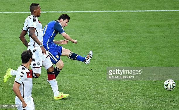 Argentina's forward and captain Lionel Messi shoots past Germany's defender Jerome Boateng during the 2014 FIFA World Cup final football match...