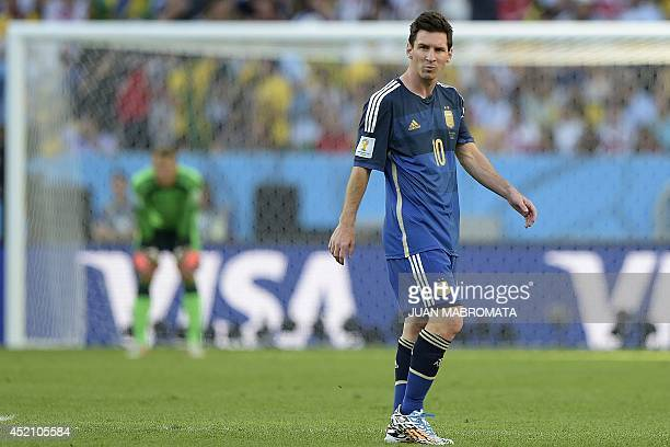 Argentina's forward and captain Lionel Messi walks in front of Germany's goal during the 2014 FIFA World Cup final football match between Germany and...