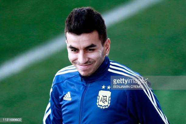 Argentina's forward Angel Correa smiles as he arrives for a training session at Real Madrid's training facilities of Valdebebas in Madrid on March 20...