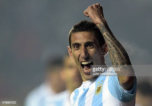 Argentina's forward Angel Di Maria celebrates after scoring against Paraguay during their Copa America semifinal football match in Concepcion Chile...