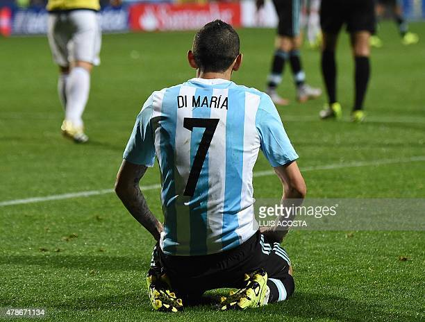 Argentina's forward Angel Di Maria is seen on the ground during the 2015 Copa America football championship quarterfinal match against Colombia in...