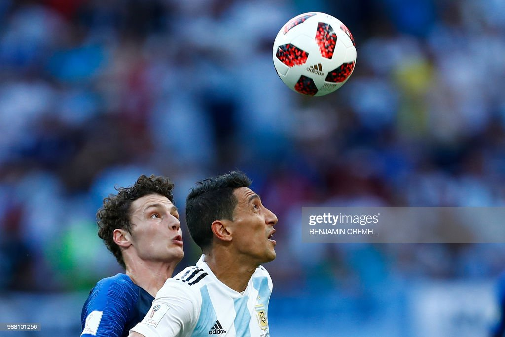 Argentina's forward Angel Di Maria (R) vies with France's defender Benjamin Pavard during the Russia 2018 World Cup round of 16 football match between France and Argentina at the Kazan Arena in Kazan on June 30, 2018. (Photo by BENJAMIN CREMEL / AFP) / RESTRICTED