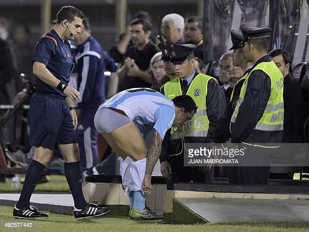 Argentina's forward Carlos Tevez changes his short during the Russia 2018 FIFA World Cup South American Qualifiers football match against Paraguay at...