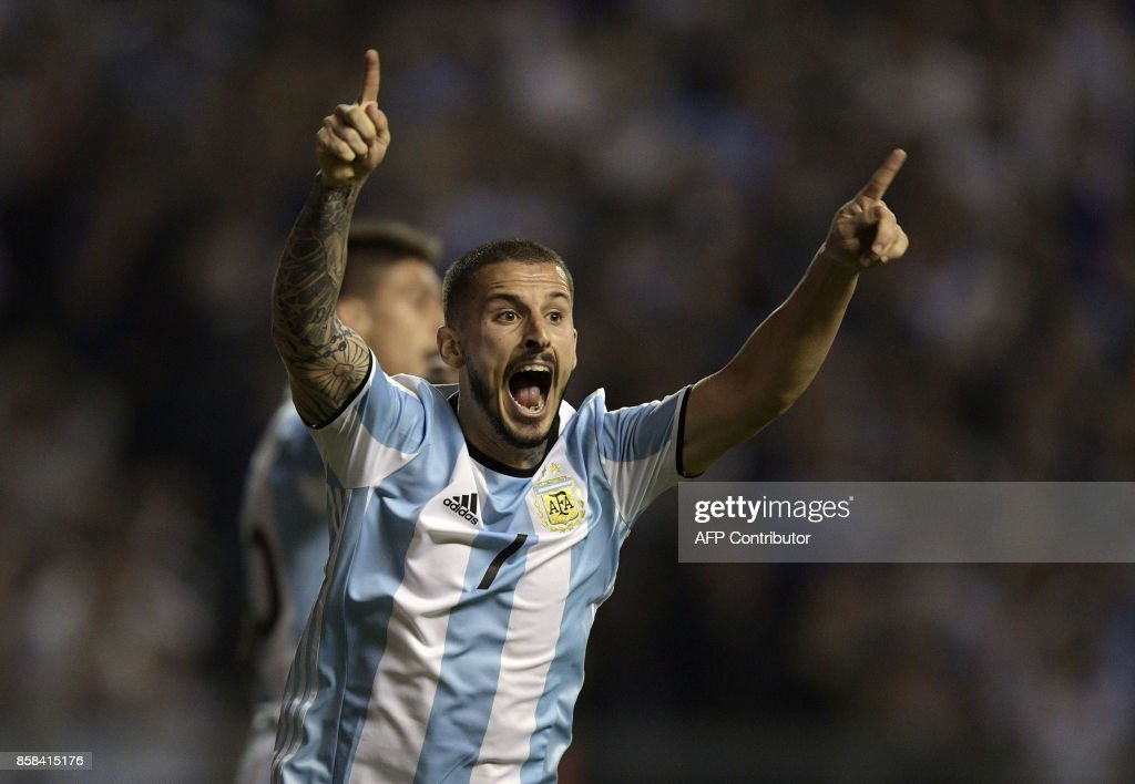 Argentina's forward Dario Benedetto reacts during a 2018 FIFA World Cup South American qualifier football match against Peru at La Bombonera stadium in Buenos Aires on October 5, 2017. /