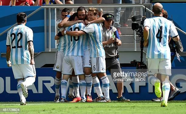 Argentina's forward Ezequiel Lavezzi Argentina's forward Lionel Messi Argentina's forward Gonzalo Higuain Argentina's midfielder Lucas Biglia and...