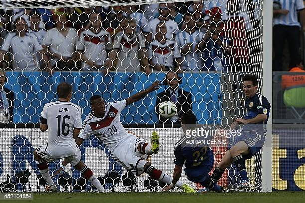 Argentina's forward Ezequiel Lavezzi takes a shot on goal as Germany's defender Jerome Boateng defends and Argentina's forward and captain Lionel...