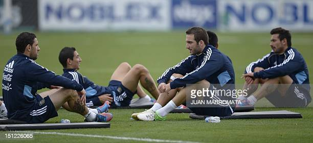 Argentina's forward Gonzalo Higuain and midfielder Maximiliano Rodriguez ake part in a training session of the national football team in Ezeiza...
