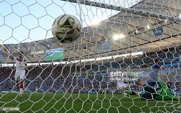 Argentina's forward Gonzalo Higuain celebrates a disallowed goal during the first half of the 2014 FIFA World Cup final football match between...