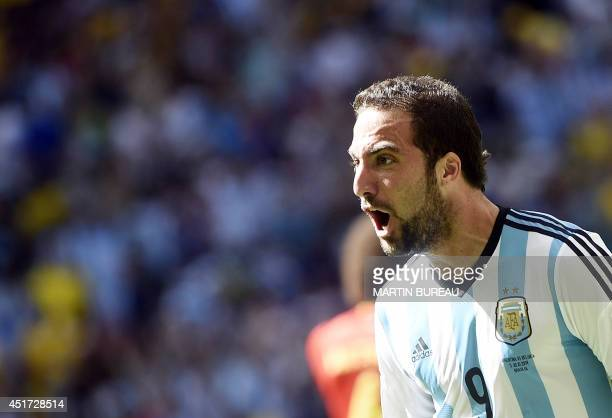 Argentina's forward Gonzalo Higuain celebrates after scoring during a quarterfinal football match between Argentina and Belgium at the Mane Garrincha...