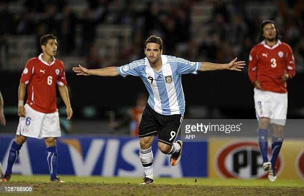 Argentina's forward Gonzalo Higuain celebrates after scoring his team's third goal against Chile during a South America qualifying round of Brazil WC...