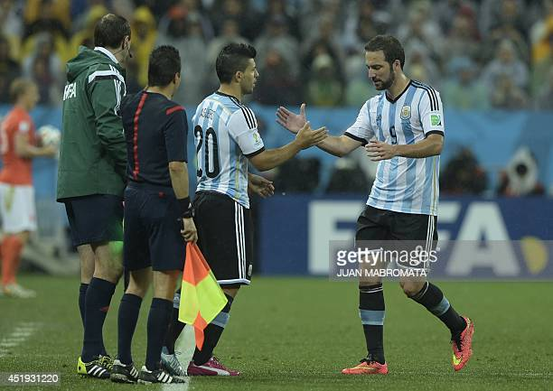 Argentina's forward Gonzalo Higuain is substituted by Argentina's forward Sergio Aguero during the semifinal football match between Netherlands and...