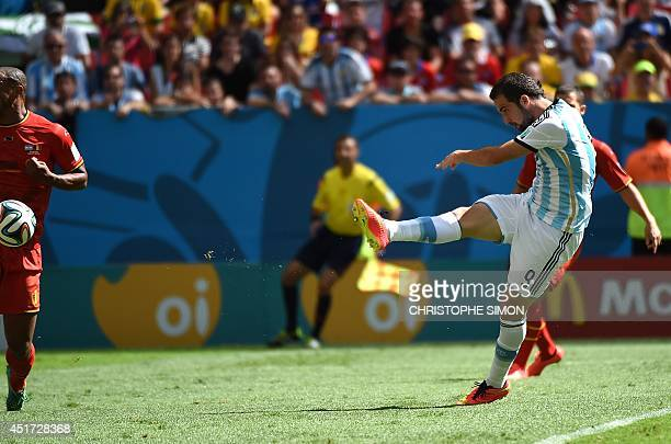 Argentina's forward Gonzalo Higuain kicks to score his team's first goal during a quarterfinal football match between Argentina and Belgium at the...