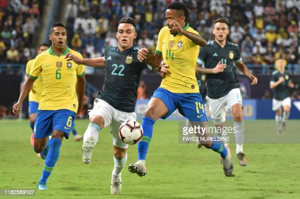 Argentina's forward Lautaro Martinez is marked by Brazil's defender Eder Militao during the friendly football match between Brazil and Argentina at...