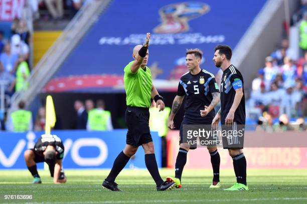 Argentina's forward Lionel Messi and Argentina's midfielder Lucas Biglia react as Polish referee Szymon Marciniak calls for a corner kick during the...