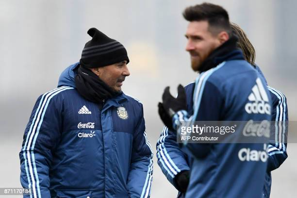 Argentina's forward Lionel Messi and Argentina's national football team coach Jorge Sampaoli take part in a training session in Moscow on November 7...