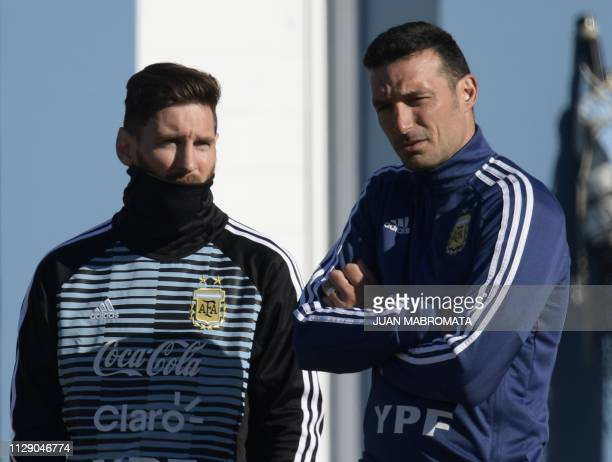 Argentina's forward Lionel Messi and assistant coach Lionel Scaloni gesture during a training session in Ezeiza Buenos Aires on May 22 ahead of the...