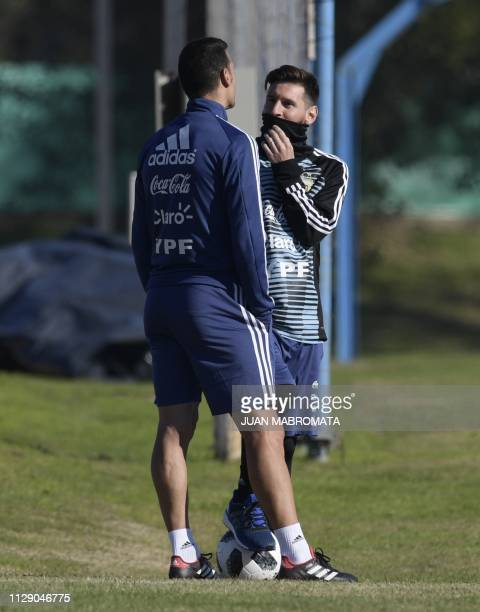 Argentina's forward Lionel Messi and assistant coach Lionel Scaloni gesture during a training session in Ezeiza Buenos Aires on May 22 2018 ahead of...