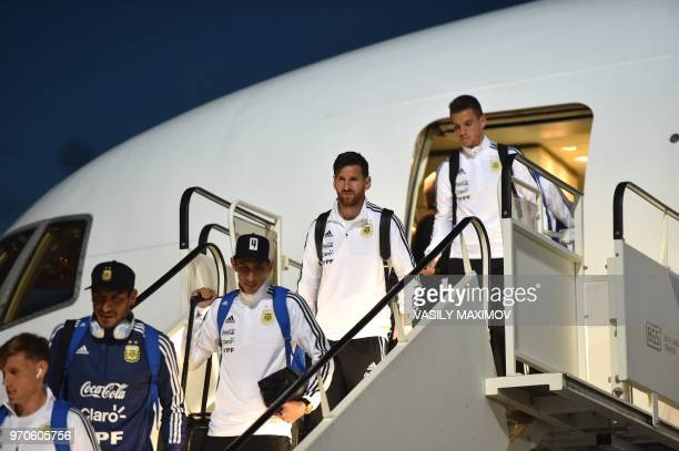 Argentina's forward Lionel Messi and Midfielder Angel Di Maria disembarks from a plane at the Zhukovsky airport near Moscow on June 9 as Argentina's...