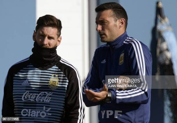 Argentina's forward Lionel Messi and team assistant Lionel Scaloni are pictured during a training session in Ezeiza Buenos Aires on May 22 2018 The...