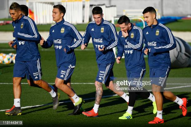 Argentina's forward Lionel Messi and teammates attend a training session at the Real Madrid's training facilities of Valdebebas in Madrid on March 18...