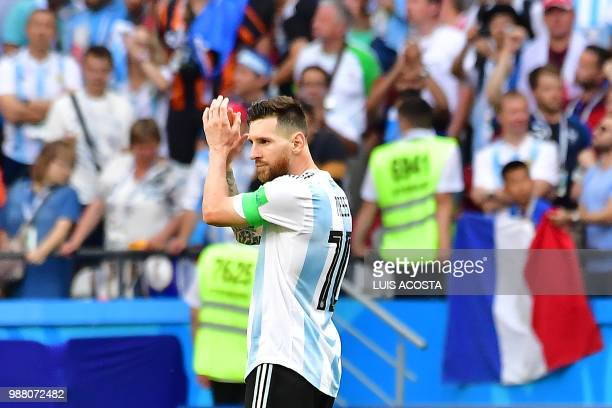 Argentina's forward Lionel Messi applauds at the end of the Russia 2018 World Cup round of 16 football match between France and Argentina at the...