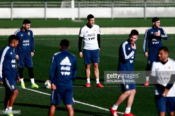 Argentina's forward Lionel Messi Argentina's midfielder Leandro Paredes and Argentina's defender Nicolas Tagliafico attend a training session at Real...